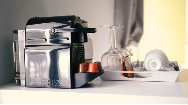 nespresso coffee machine in each room along with free coffee pods daily